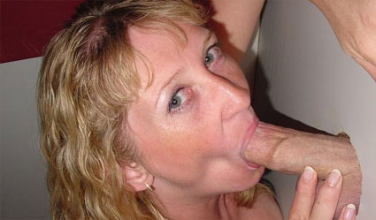 summer sucks cock through a glory hole